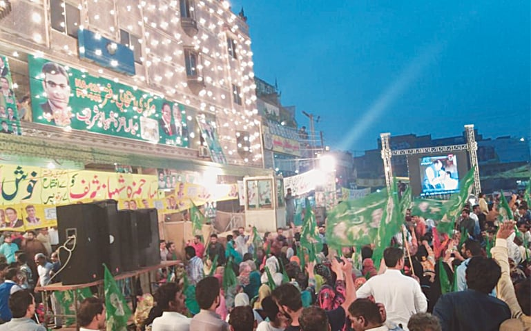 PML-N supporters gather in front of a plaza at Bhati Gate for the inauguration of the election office of NA-124 candidate Hamza Shahbaz.—Photo by writer