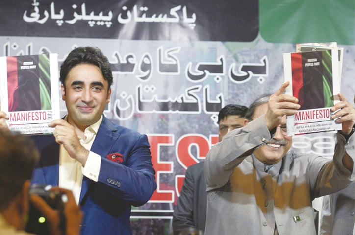 BILAWAL Bhutto-Zardari and his father hold copies of the PPP's manifesto. —Tanveer Shahzad/White Star
