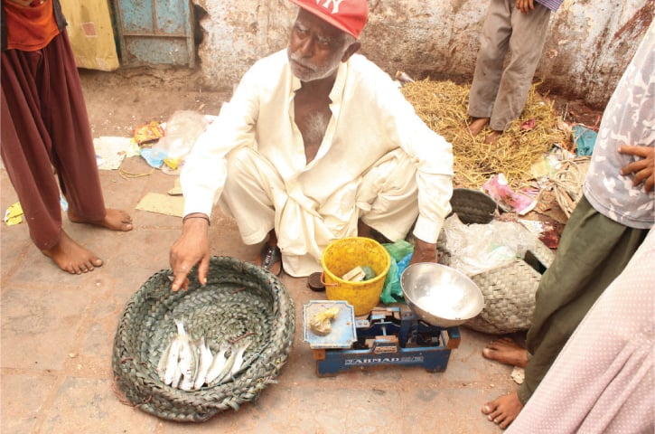 Ahmad selling his meagre catch in the off-season