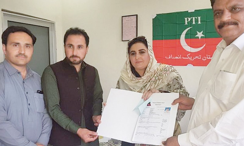 IN this file photo, Hameeda Shahid, a leader of the women wing of Pakistan Tehreek-i-Insaf, submits an application with her party leadership to seek permission for taking part in the upcoming general elections.—Dawn
