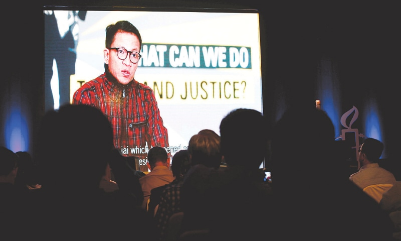 Jakarta: Amnesty International Indonesia Executive Director Usman Hamid is projected on a screen as he speaks during a briefing on Monday.—Reuters