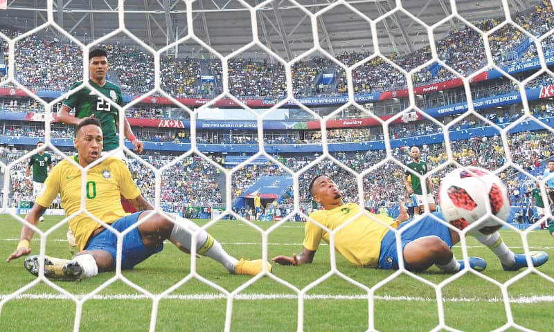 SAMARA: Brazil's Neymar (L) taps in to score against Mexico during the round-of-16 match at the Samara Arena on Monday.—AFP