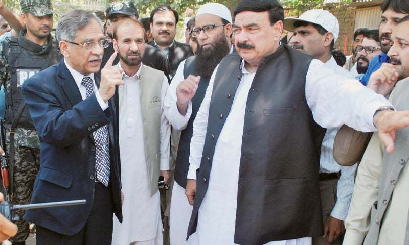 CJP Nisar and Sheikh Rashid visit hospital in Rawalpindi on Sunday. ─ File