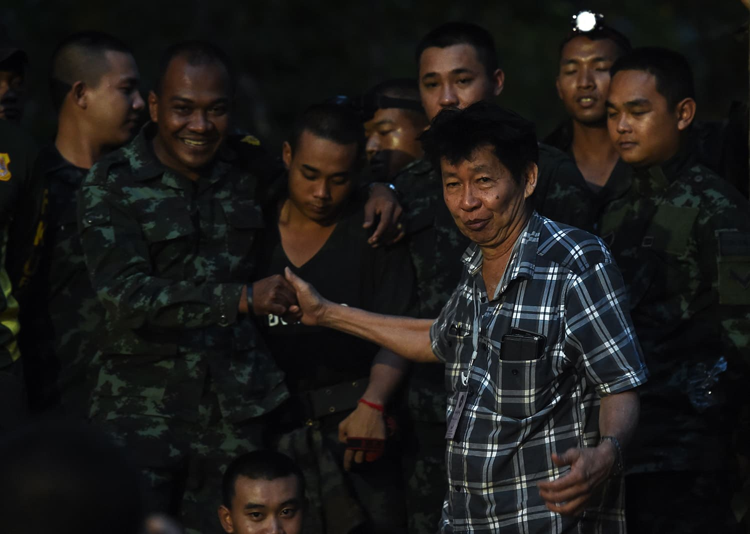 The father of a missing footballer thanks soldiers near Tham Luang cave following news all members of the children's football team and their coach were alive. —AFP