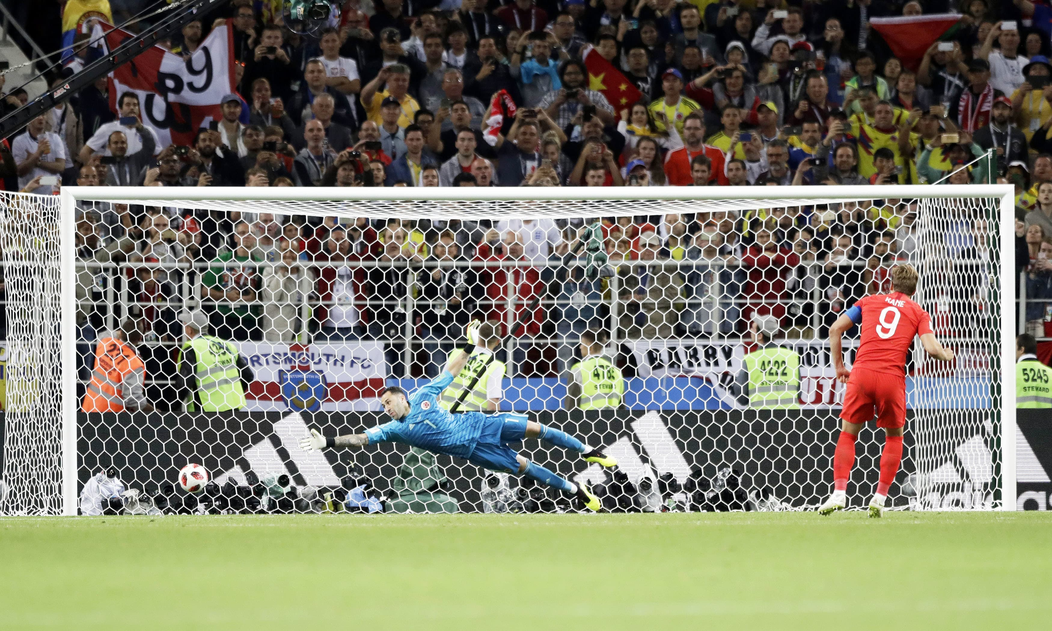 England's Harry Kane scores on a penalty shootout during the round of 16 match against Colombia. —AP