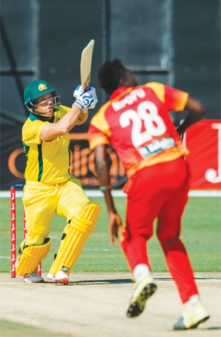 HARARE: Australia's opening batsman Aaron Finch plays a shot during the T20 tri-series match against Zimbabwe at the Harare Sports Club on Tuesday.—AFP