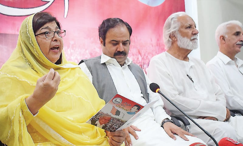 QWP central general secretary Anisa Zeb Tahirkheli presents party  manifesto at a press conference in Peshawar on Wednesday. — White Star