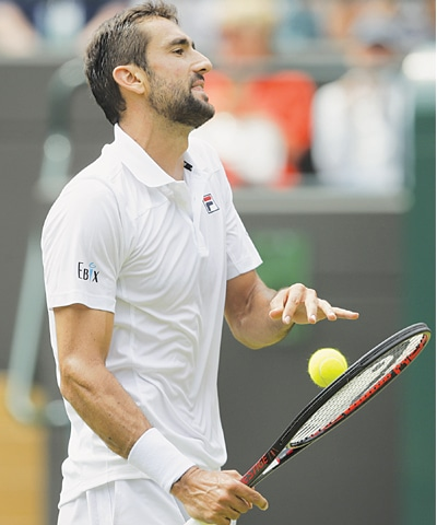 MARIN Cilic loses a point to Guido Pella during their second-round match at Wimbledon on Thursday.—AP