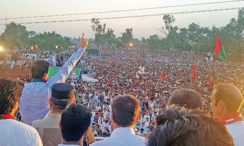 PTI chief Imran Khan addressing a public meeting in Charsadda on Thursday. — Dawn