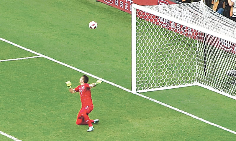 FERNANDO Muslera fails to stop this shot from French striker Antoine Griezmann.—AP