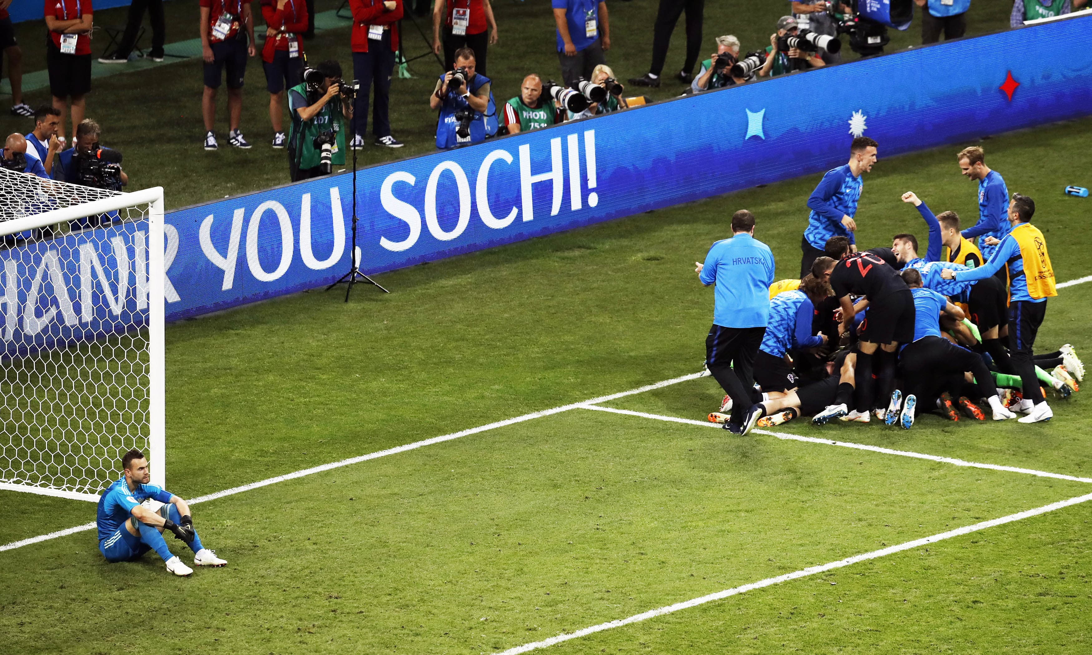 Russia goalkeeper Igor Akinfeev reacts as Croatia players celebrate after scoring the winning penalty during the quarterfinal match. —AP