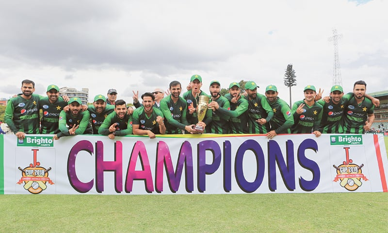 The victorious Pakistan team members pose with the winners' trophy.—AP