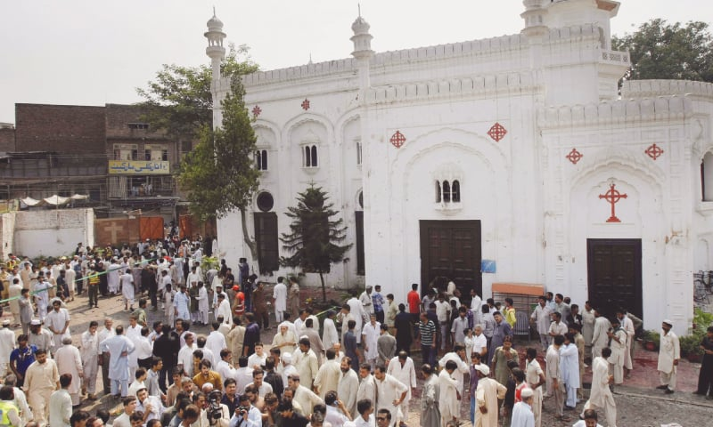 IN this file photo, people gather outside All Saints Church in Peshawar after a suicide bombing attack killed more than 70 people and left 120 injured. In the aftermath of the attack, then chief justice of Pakistan Tassaduq Hussain Jillani took suo motu notice of the state of religious minorities in the country and issued an eight-point directive to improve their situation.—AP