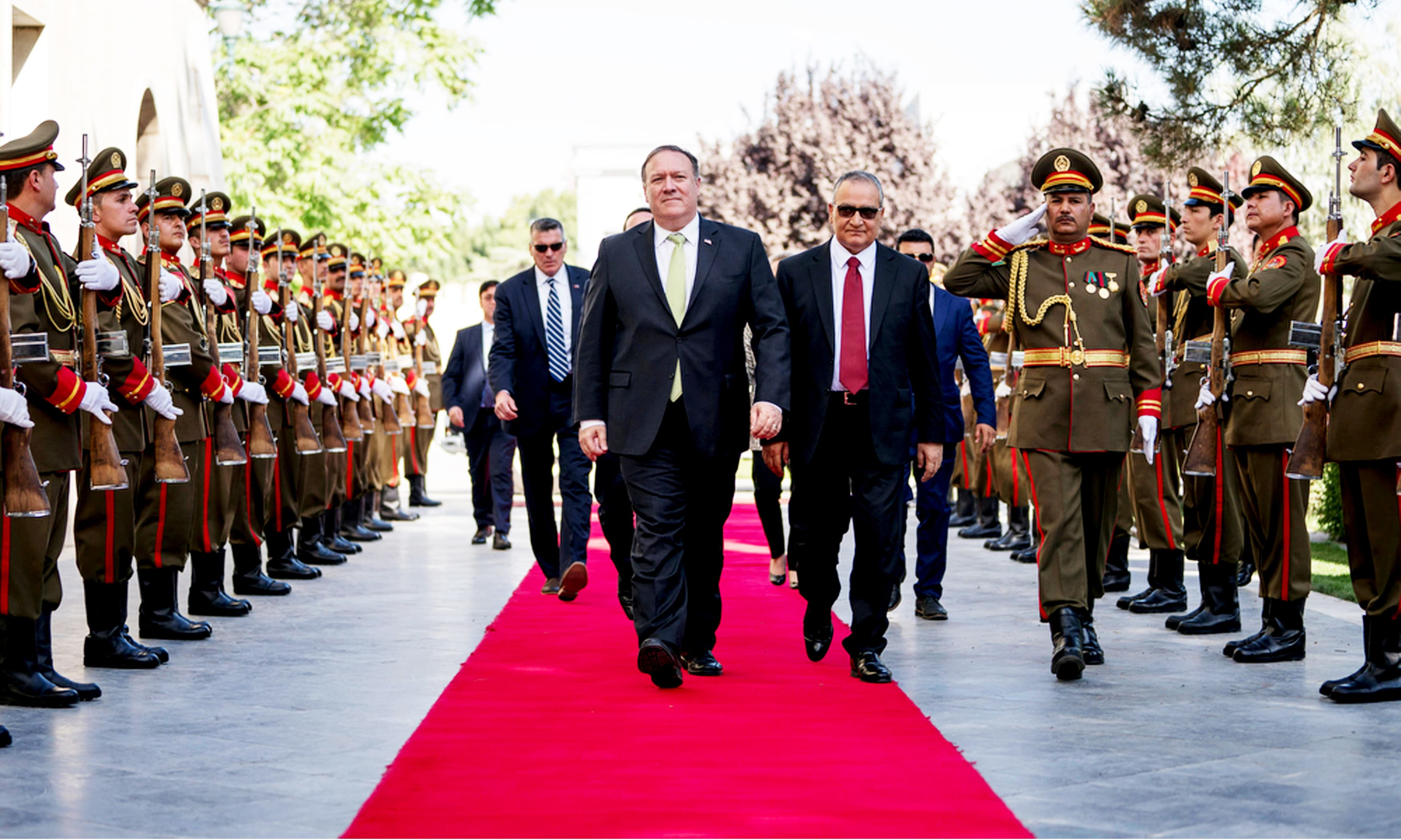 US Secretary of State Mike Pompeo is greeted by Afghan Chief of Staff Abdul Salam Rahimi, as he arrives at Gul Khanna in the Presidential Palace in Kabul. —AP