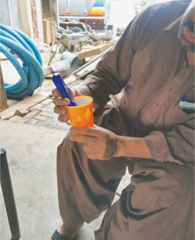 A MAN uses a digital instrument to measure if the groundwater he has access to is drinkable or not.—Photo by writer