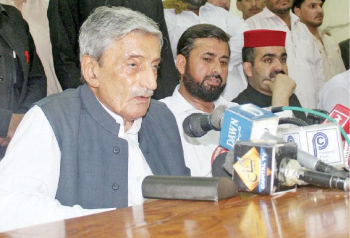 Ghulam Ahmed Bilour addresses a presser in Peshawar on Monday. — INP
