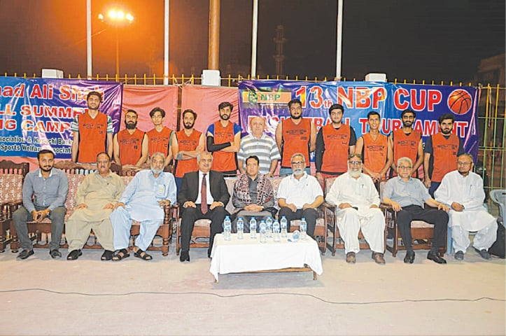 KARACHI: Deputy Commissioner South Syed Salahuddin is seen with defending champions Bounce Club outfit along with KBBA president Ghulam Mohammad and PSWA's Khalid Shamsi at the opening of the 13th National Basketball Cup.