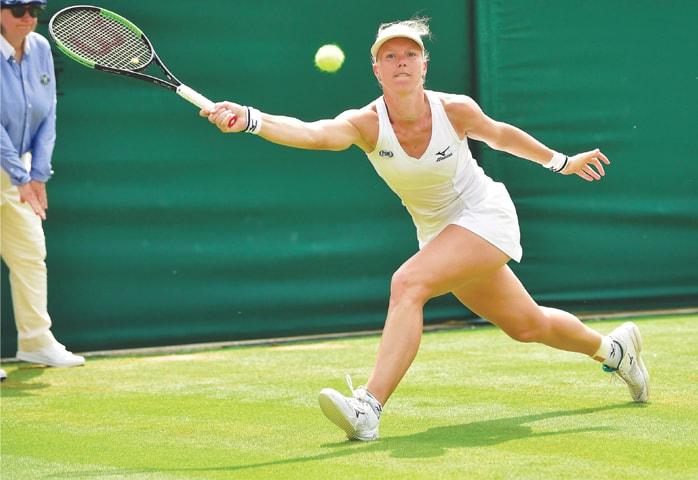 LONDON: Netherlands' Kiki Bertens stretches to hit a return against Karolina Pliskova of the Czech Republic during their fourth-round match at Wimbledon on Monday.—AFP