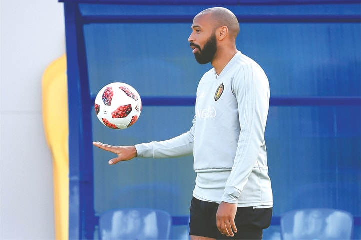 BELGIUM'S assistant coach Thierry Henry plays with the ball during a training session in Dedovsk on Monday.—AFP