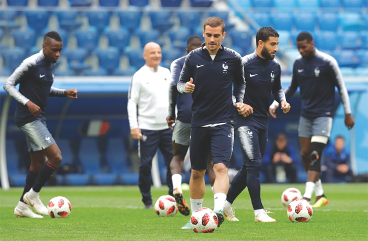 ST PETERSBURG: France's Antoine Griezmann (front) and team-mates practise on Monday at the St Petersburg Stadium.—Reuters