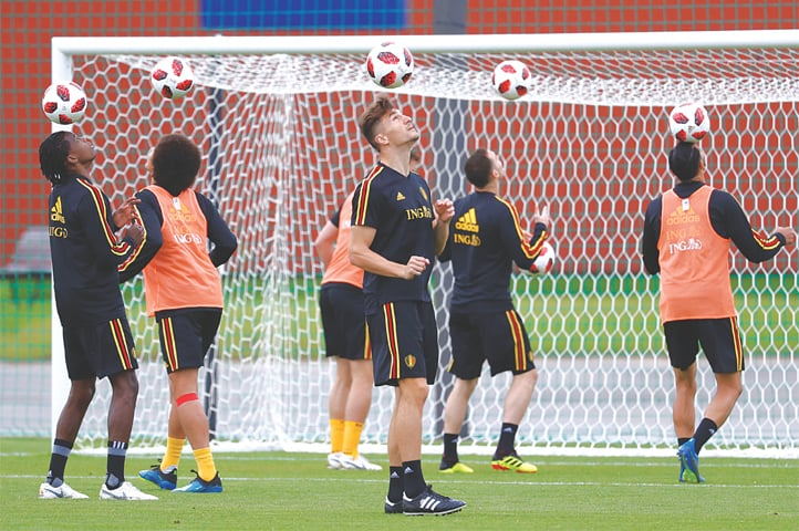 DEDOVSK: Belgium's defender Thomas Meunier (C) and team-mates eye the ball as they prepare for the semi-final against France during a training session at the Guchkovo Stadium on Monday.—Reuters