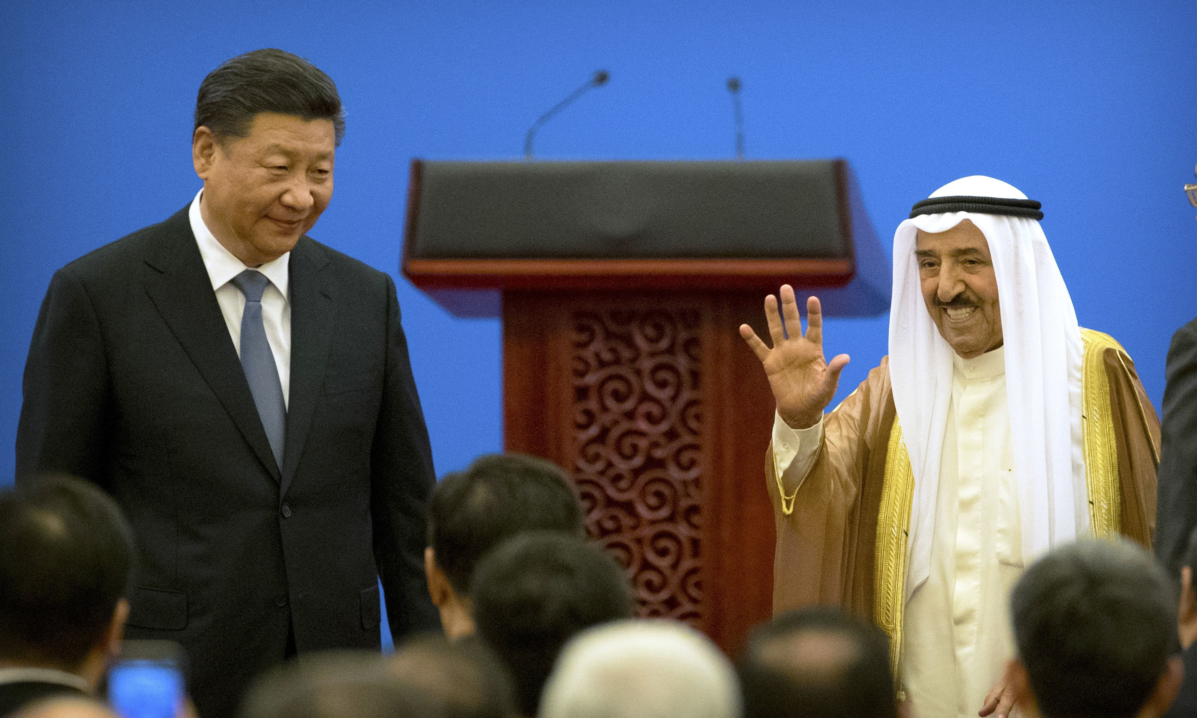 Kuwait's ruling emir, Sheikh Sabah Al Ahmad Al Sabah, right, waves as he stands with Chinese President Xi Jinping after speaking during the opening session of the 8th Ministerial Meeting of the China-Arab States Cooperation Forum in Beijing, Tuesday, July 10, 2018. — AP