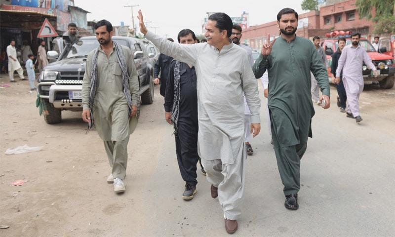 PML-N candidate Mian Javaid Latif visits his constituency. He alleges the loyalties of some PML-N local body members are being changed. He claims his party is not being given a level playing field. —Murtaza Ali/White Star