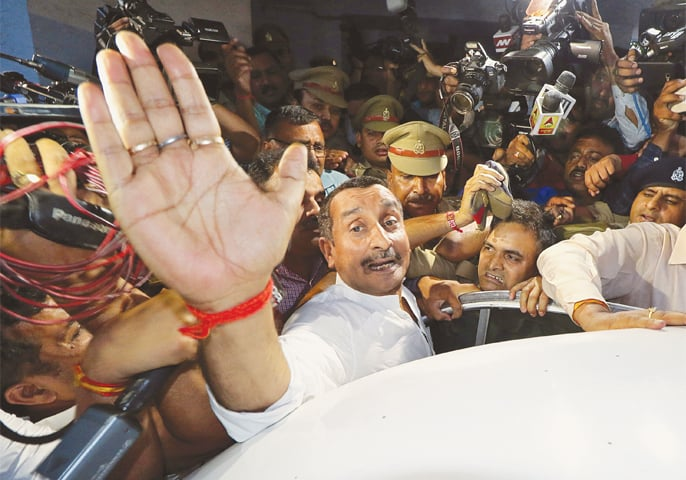A FILE photo of Kuldeep Singh Sengar, a legislator of Uttar Pradesh state from India's ruling Bharatiya Janata Party, reacts as he leaves a court after he was arrested on Friday in connection with the rape of a teenager in Lucknow on April 14.—Reuters