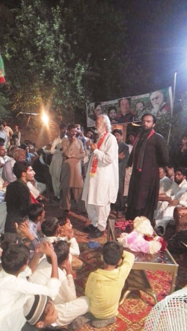 SARDAR Aseff Ahmed Ali of the PTI in a corner meeting in Mustafabad (PP-175).—Dawn