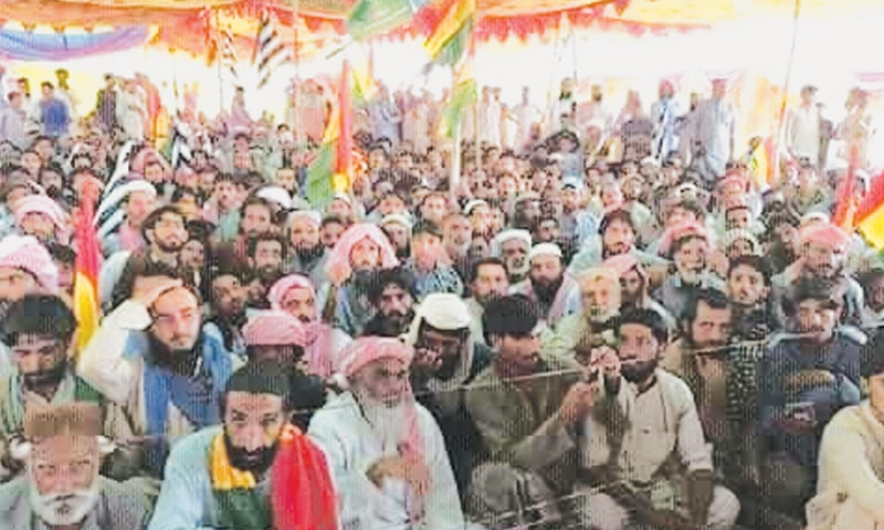 PEOPLE gather at a public meeting in Khuzdar as leaders of the BNP-M and MMA address the crowd.—Dawn
