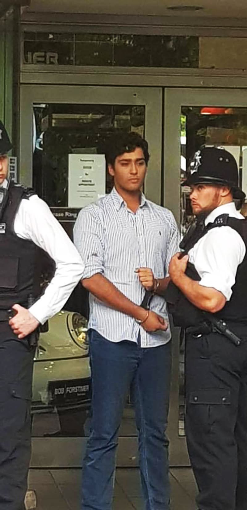 London police take Junaid Safdar into custody. —DawnNewsTV