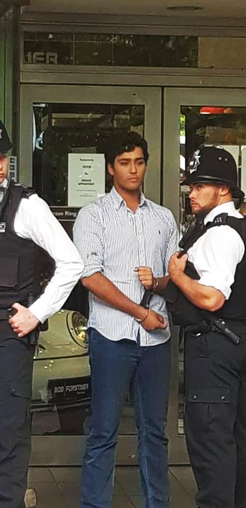 London police take Junaid Safdar into custody. —DawnNewsTV