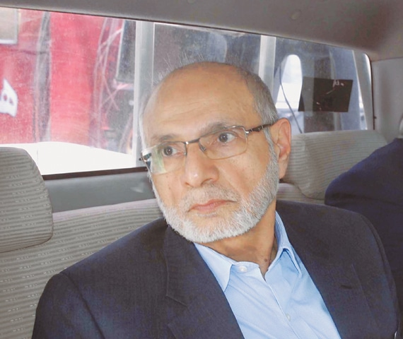 FORMER chairman of the Pakistan Stock Exchange Hussain Lawai being produced before apex court on Thursday.—Online