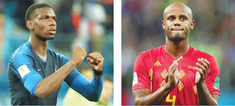 FRANCE'S Paul Pogba (left) and Belgium's Vincent Kompany (right) during their semi-final match in Moscow on Tuesday. Half of the French and Belgian squads' players trace their ancestry to Africa.—Reuters