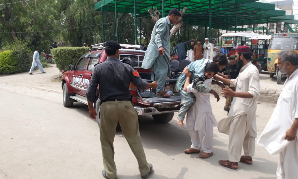 Injured being shifted to DHQ Bannu. — Phot by Author
