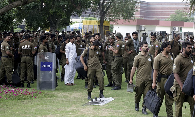 Police officers deployed at Lahore airport. ─ AP