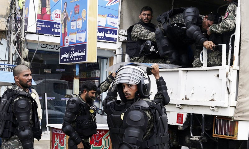 Paramilitary troops arrive in Lahore for maintenance of law and order in run-up to Nawaz Sharif and Maryam Nawaz's arrival at Lahore airport. ─ AP