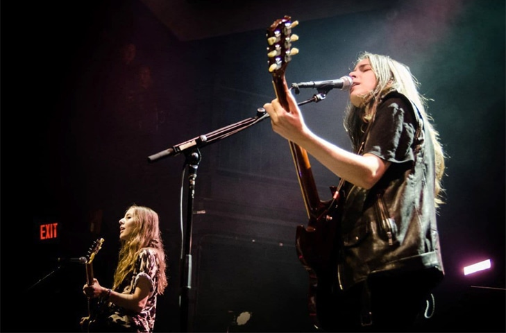 Danielle Haim, right, and Alana Haim of the band Haim perform at a sold-out show at the 9:30 Club in Washington, D.C. | Josh Sisk