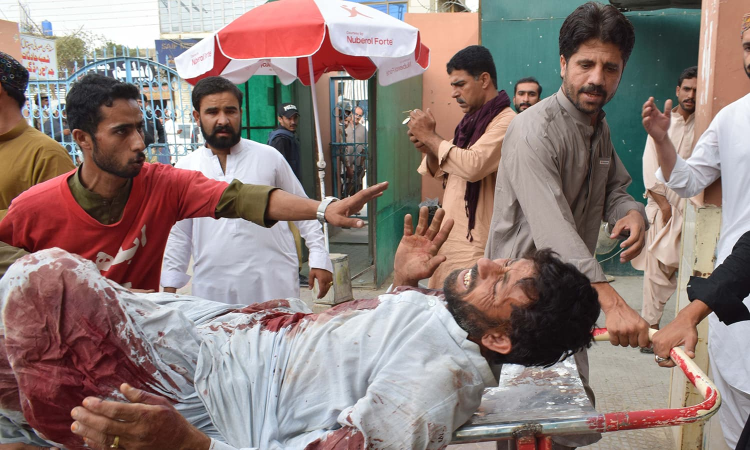 A man is brought to a hospital in Quetta  following the bomb blast at an election rally in Mastung. —AFP