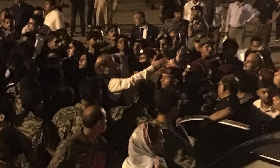 Nawaz Sharif is taken into custody at the Lahore airport. Photo: Zahrah Mazhar