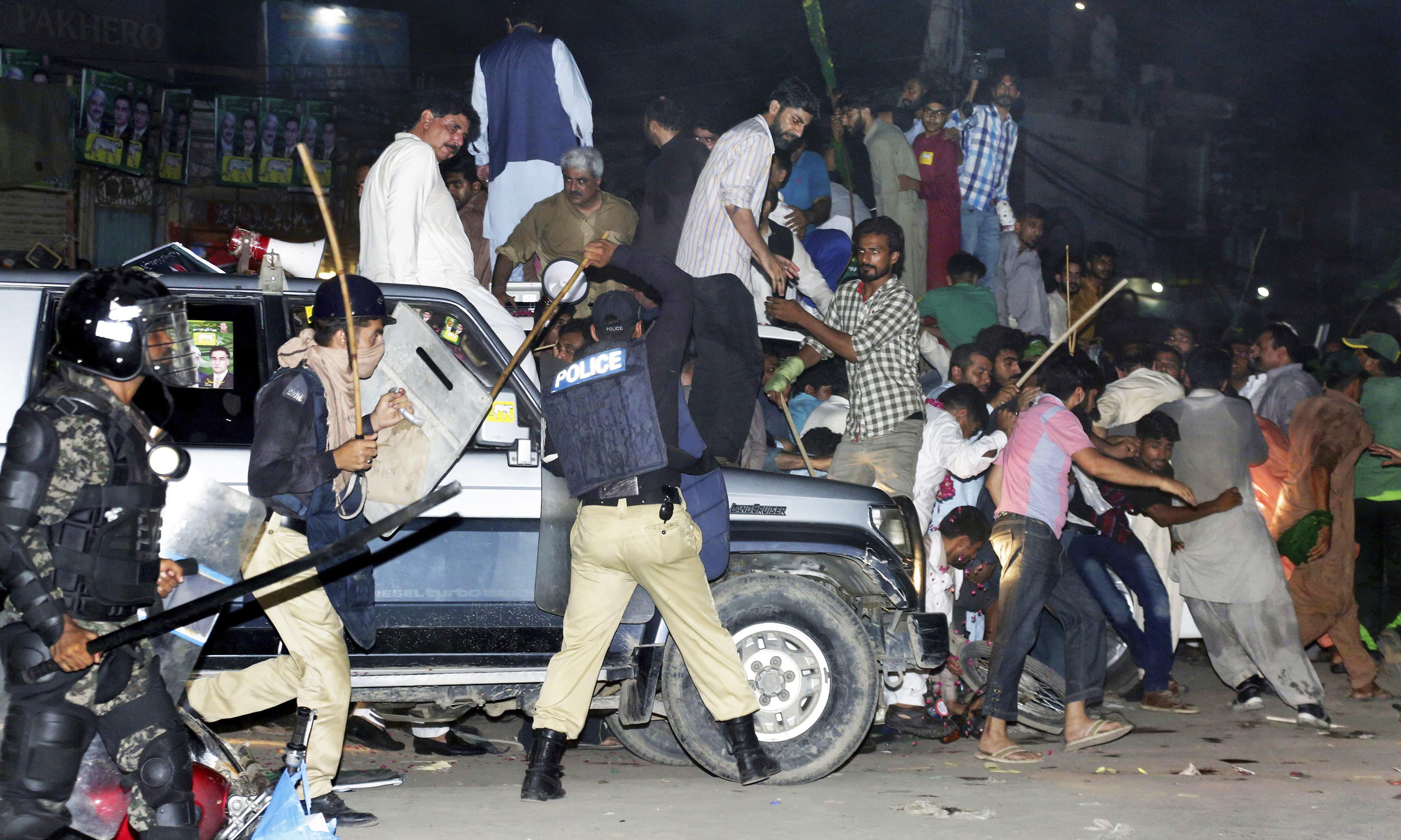 Police use force to disperse supporters of former prime minister Nawaz Sharif who gathered to see him in Lahore. —AP