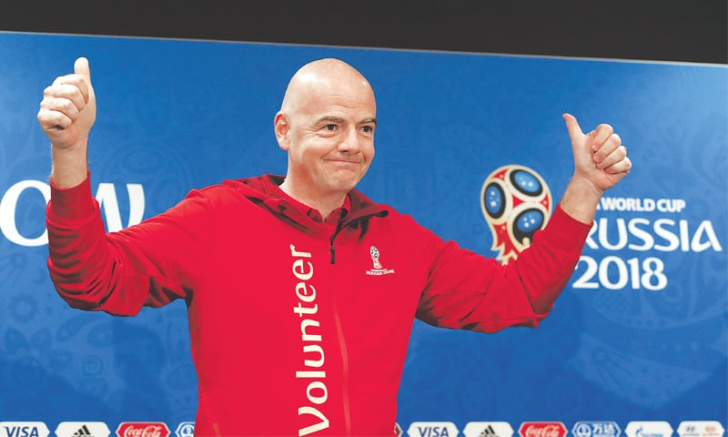 MOSCOW: FIFA president Gianni Infantino greets the audience before addressing a news conference at the Luzhniki Stadium on Friday.—Reuters