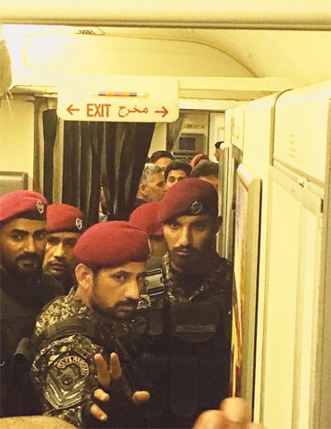 PARAMILITARY personnel enter the plane to take Nawaz Sharif into custody.—Photo by writer