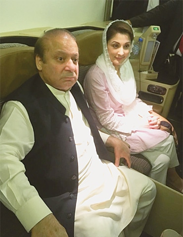 NAWAZ Sharif and his daughter Maryam pictured on board the Lahore-bound flight moments before they were arrested on Friday. Photo: Zahrah Mazhar