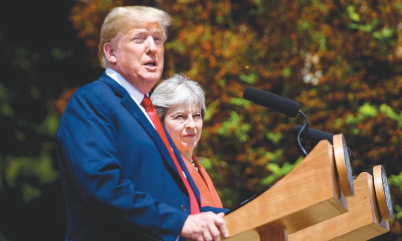 US President Donald Trump and Britain's Prime Minister Theresa May hold a joint press conference following their meeting at Chequers on Friday. On his way to Britain last week, the US leader voiced support for a 'hard Brexit' favoured by rabid Brexiteers Boris Johnson, who has resigned as foreign secretary, and Nigel Farage, leader of the UK Independence Party.—AFP