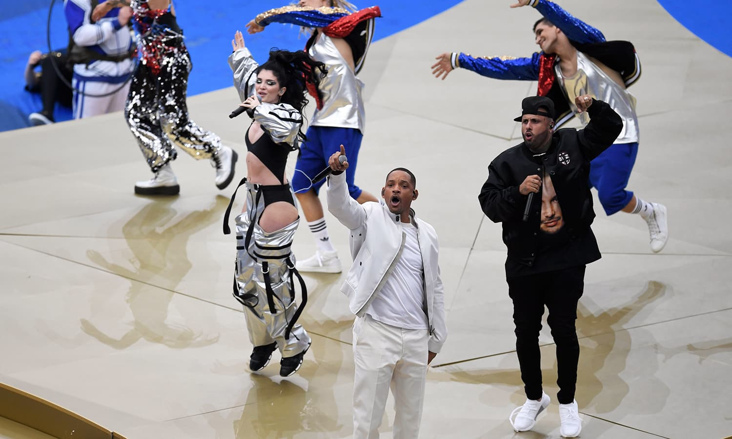 US singer Will Smith (C), Kosovo's singer Era Istrefi (L) and US rapper Nick Rivera Caminero aka Nicky Jam (R) perform during the closing ceremony prior to the Russia 2018 World Cup final match. — AFP