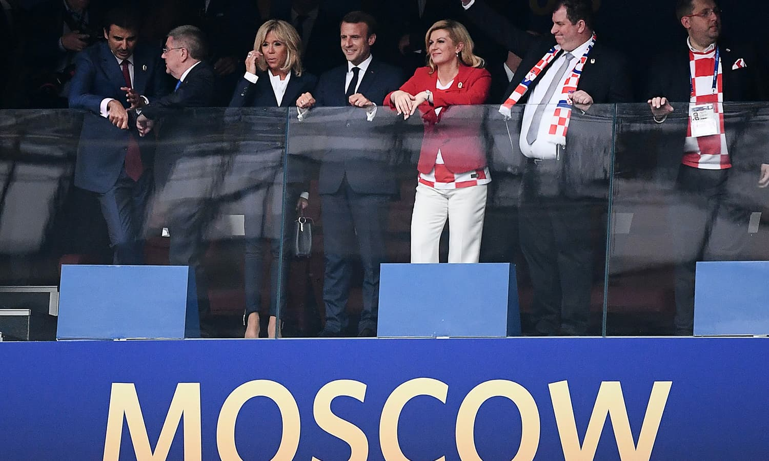 (L to R) Emir of Qatar Sheikh Tamim bin Hamad Al-Thani, IOC President Thomas Bach, French First lady Brigitte Macron, French President Emmanuel Macron, Croatian President Kolinda Grabar-Kitarovic and her husband Jakov Grabar-Kitarovic attend the Russia 2018 World Cup final. — AFP