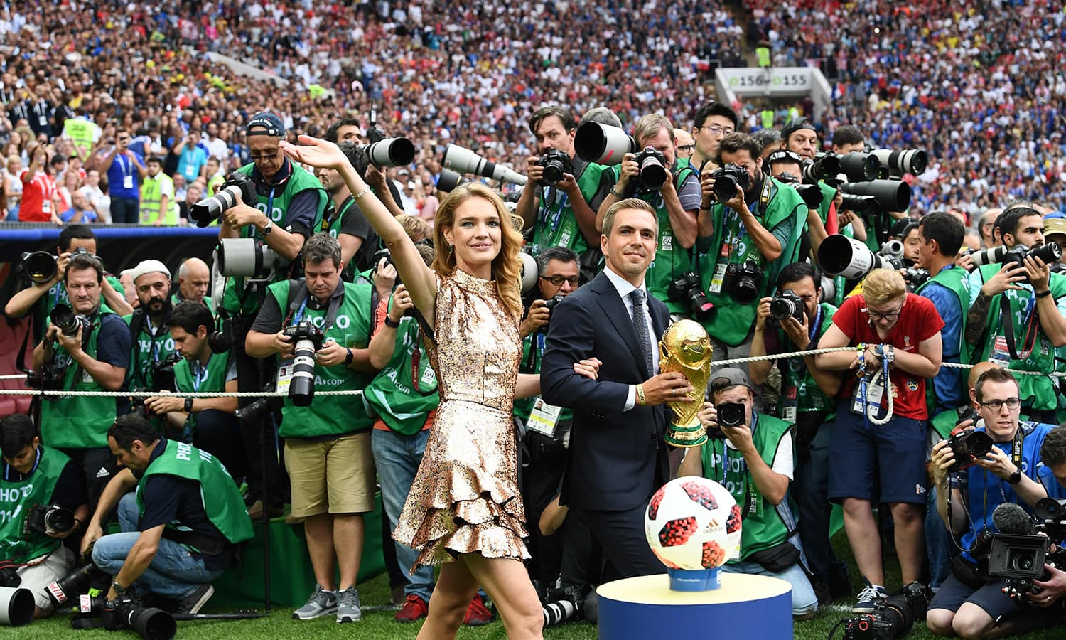 Germany's former captain Philipp Lahm (R) and Russian model Natalia Vodianova pose with the World Cup trophy during the closing ceremony of the Russia 2018 World Cup at the Luzhniki Stadium in Moscow.  — AFP