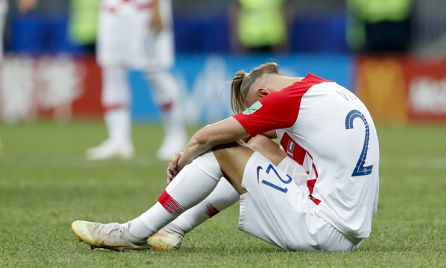 Croatia's Domagoj Vida sits on the pitch at the end of the final match between France and Croatia. — AP