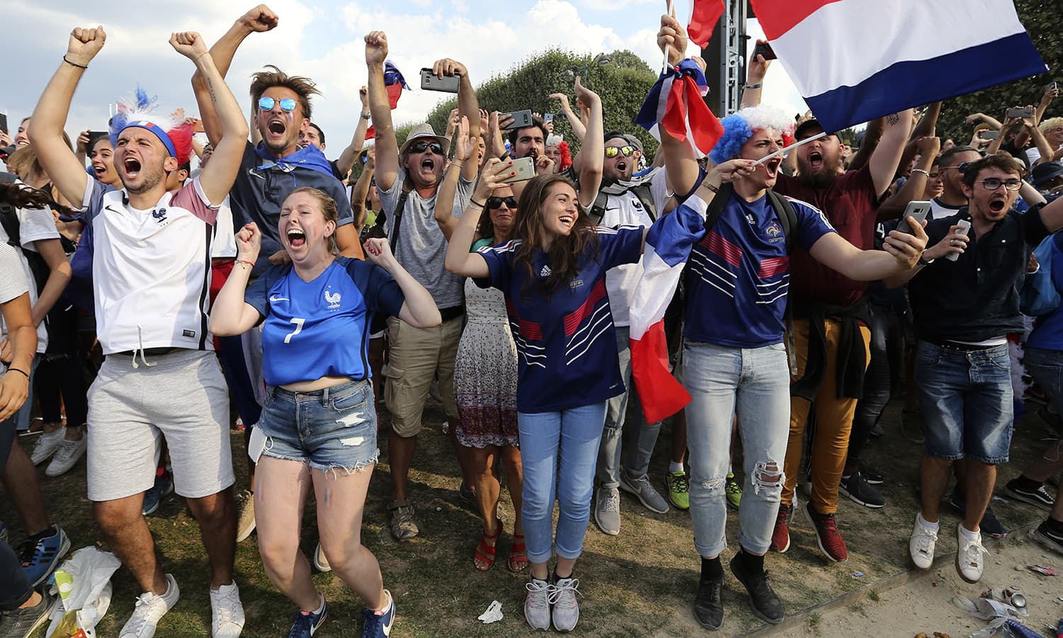 Supporters of the French football team celebrate after France won the World Cup final between France and Croatia on the Champ de Mars in Paris. — AP